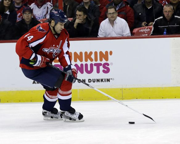 Washington Capitals defenseman Roman Hamrlik (44) from the Czech Republic, skates with the puck in the second period of an NHL hockey game against the Montreal Canadiens Thursday, Jan. 24, 2013 in Washington. (AP Photo/Alex Brandon)