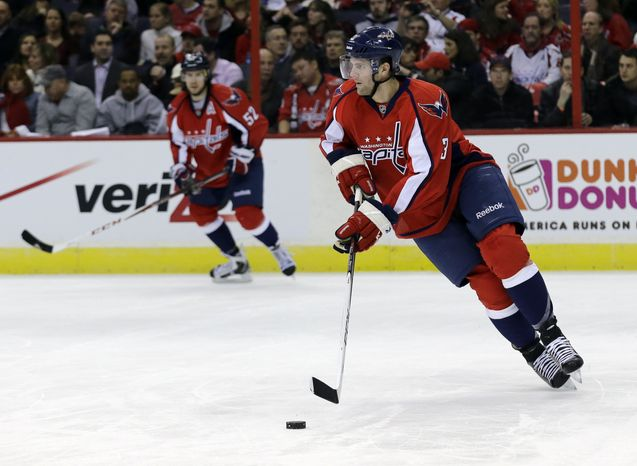 Washington Capitals defenseman Tom Poti (3) skates with the puck in the second period of an NHL hockey game against the Montreal Canadiens Thursday, Jan. 24, 2013 in Washington. (AP Photo/Alex Brandon)