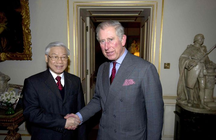 Britain's Prince Charles, the Prince of Wales, greets Vietnamese General Secretary of the Communist Party Nguyen Phu Trong, left, at Clarence House in central London, Wednesday, Jan. 23, 2013. (AP Photo/Carl Court, Pool)
