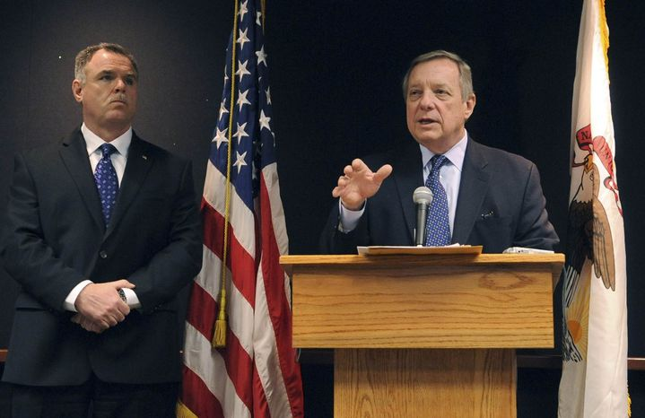 Sen. Dick Durbin, D-Ill., appearing with Chicago Police Superintendent Garry McCarthy, left, speaks at a news conference in Chicago, Friday, Jan. 25, 2013, in his push to pass two new gun laws, including one he co-sponsored that would ban assault weapons. (AP Photo/Chicago Sun-Times, Brian Jackson)