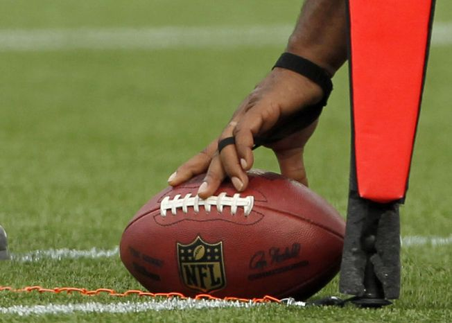 FILE - In this Sept. 12, 2012, file photo, officials measure for a Cincinnati Bengals first down during the second quarter an NFL football game against the New England Patriots, in Foxborough, Mass. (AP Photo/Michael Dwyer, File)