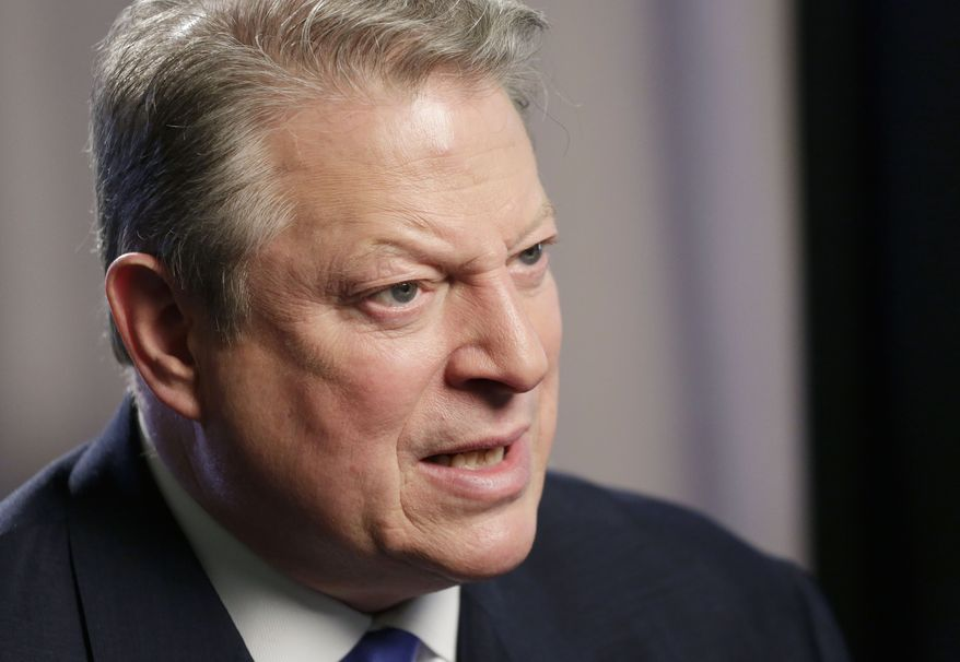 "**FILE** Former U.S. Vice President Al Gore talks during an interview on Jan. 29, 2013, in New York. Gore, who takes aim in his new book at the corporate media for ""suffocating the free flow of ideas,"" defended the sale of his own television channel to Al-Jazeera. (Associated Press)"