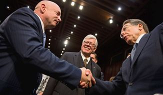 "National Rifle Association President David Keene (center) and NRA Executive Vice President Wayne LaPierre (right) greet Mark Kelly, husband of former Rep. Gabrielle Giffords, after a hearing Wednesday before the Senate Judiciary Committee on ""What Should America Do About Gun Violence?"" (Andrew Harnik/The Washington Times)"