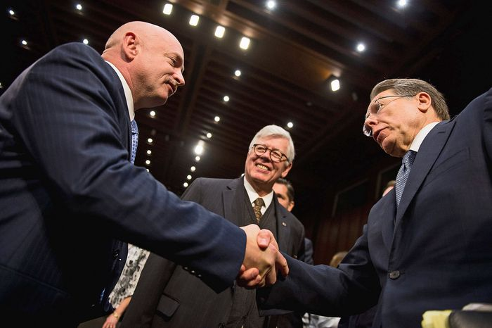 """National Rifle Association President David Keene (center) and NRA Executive Vice President Wayne LaPierre (right) greet Mark Kelly, husband of former Rep. Gabrielle Giffords, after a hearing Wednesday before the Senate Judiciary Committee on """"What Should America Do About Gun Violence?"""" (Andrew Harnik/The Washington Times)"""