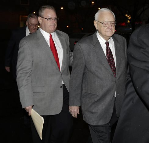 Former Illinois Gov. George Ryan (right) is accompanied by son George H. Ryan Jr. (left) as he arrives at a halfway house in Chicago on Wednesday, Jan. 30, 2013, after serving five-plus years in federal prison on corruption charges. (AP Photo/M. Spencer Green)