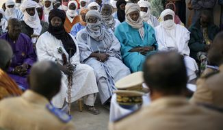 Elders meet with the mayor and the governor of Gao in Gao city, Mali, on Wednesday, Jan. 30, 2013, in an effort to avoid vengeance attacks following the arrival of French and Chadian troops in the area, ending 10 months of sharia law. (AP Photo/Jerome Delay)