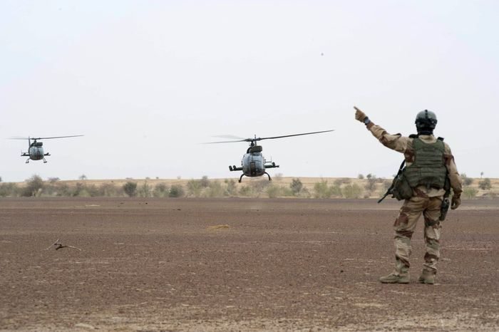 A French soldier directs helicopters near Timbuktu, Mali, on Jan. 28, 2013. Backed by French helicopters and paratroopers, Malian soldiers entered the fabled city of Timbuktu on Monday after al Qaeda-linked militants who ruled the outpost by fear for nearly 10 months fled into the desert, setting fire to a library that held thousands of manuscripts dating to the Middle Ages. (Associated Press/French Army Communications Audiovisual office)