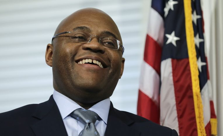"""William """"Mo"""" Cowan smiles Jan. 30, 2013, during a news conference at the Statehouse in Boston where he was selected to fill John F. Kerry's seat on an interim basis in the Senate. Kerry was confirmed by the Senate the previous day to be the nation's next secretary of state. (Associated Press"""