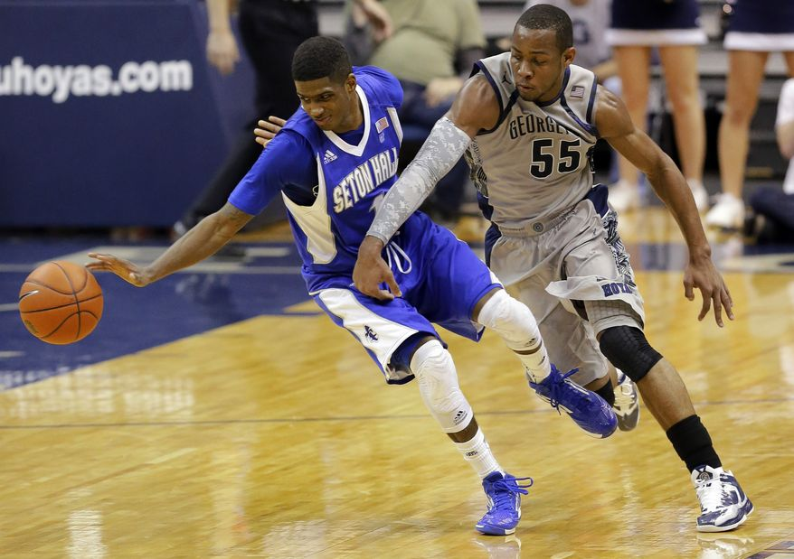 Seton Hall guard Aaron Cosby (1) goes for a loose ball with Georgetown guard Jabril Trawick during the second half of Georgetown's 74-52 win on Jan. 30, 2013, in Washington. (Associated Press)