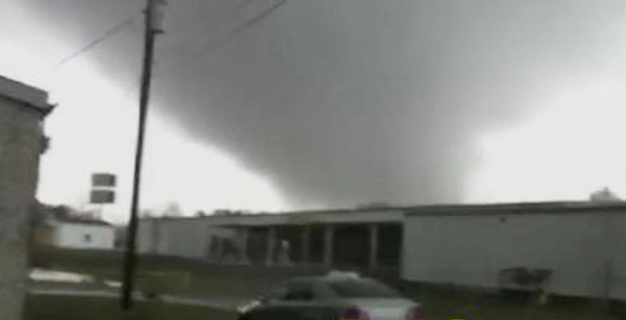 A tornado moves through Adairsville, Ga., on Wednesday, Jan 30, 2013. The accompanying storm has left overturned vehicles on Interstate 75 northwest of Atlanta, an official said, and crews are responding to reports of people trapped in storm-damaged residential and commercial buildings. (AP Photo/WSB-TV)
