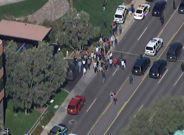 This frame grab provided by abc15.com shows the scene at a Phoenix office complex where police say someone shot at least three people on Wednesday, Jan. 30, 2013. Officer James Holmes said the victims were taken to hospitals and did not know if their injuries were life threatening. (AP Photo/abc15.com)
