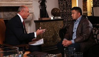 "Talk show host Dr. Phil McGraw (left) interviews Ronaiah Tuiasosopo on Jan. 24, 2013, during taping for the ""Dr. Phil Show"" in Los Angeles. The two-part program, scheduled to air Jan. 31 and Feb. 1, is the first on-air interview of Tuiasosopo, the man who allegedly concocted the girlfriend hoax that ensnared Notre Dame football star Manti Te'o. (Associated Press/CBS Television Distribution/Peteski Productions)"