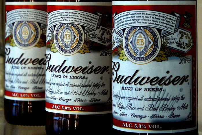 ** FILE ** In this Jan. 27, 2009, file photo, bottles of Budweiser beer are seen at the Stag Brewery in London. Anheuser-Busch InBev SA agreed Friday, June 29, 2012, to buy the half of Corona maker Grupo Modelo it doesn't already own for $20.1 billion in cash, in a deal that will greatly increase the size and dominance of the world's largest brewer. (AP Photo/Kirsty Wigglesworth, File)