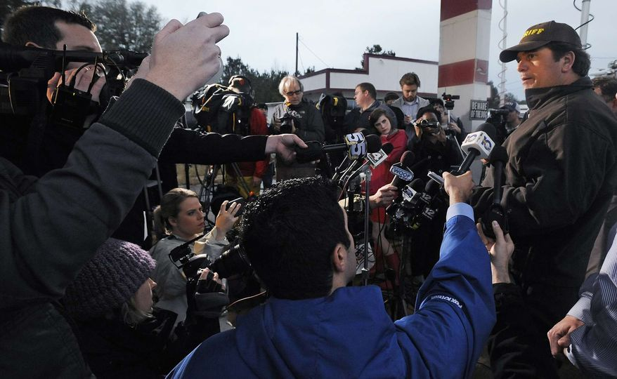 Dale County Sheriff Wally Olsen, right, briefs the media at the Dale County hostage scene in Midland City, Ala., on Wednesday, Jan. 30, 2013. (AP Photo/Montgomery Advertiser, Mickey Welsh)