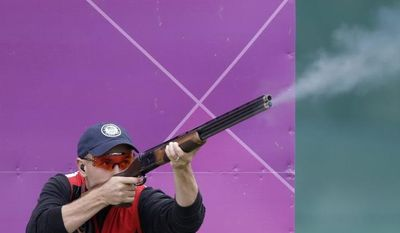 ** FILE ** U.S. skeet shooter Vincent Hancock fires July 31, 2012, during the men's skeet event at the 2012 Summer Olympics in London. Hancock finished first to win the gold medal. (Associated Press)