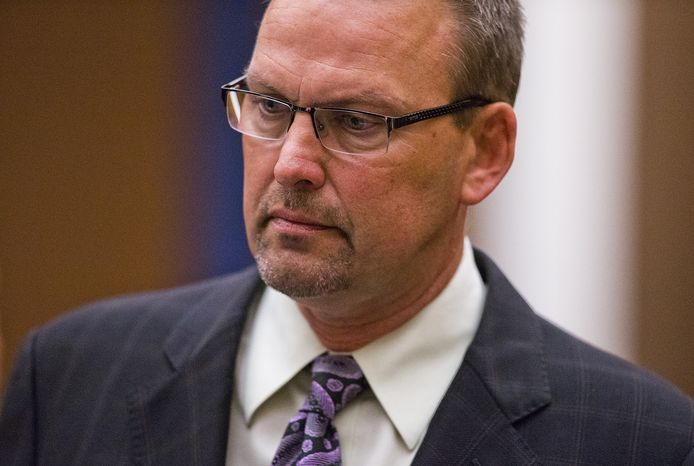 Former Arizona Diamondbacks television analyst Mark Grace stands in the gallery, Thursday, Jan. 31, 2013, before pleading guilty to felony endangerment and misdemeanor driving under the influence of alcohol at Maricopa County Superior Court in Phoenix. The 48-year-old former first baseman with the Diamondbacks and the Chicago Cubs was fired after he was arrested last August in Scottsdale, his second drunken driving arrest in 15 months. Grace had pleaded not guilty in October to four felony counts of aggravated DUI and was scheduled to go on trial March 19. (AP Photo/The Arizona Republic, Tom Tingle)