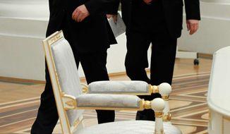 Russian President Vladimir Putin and Prime Minister Dmitry Medvedev, left, walk before a government meeting in the Kremlin in Moscow, Thursday, Jan. 31, 2013. (AP Photo/RIA-Novosti, Dmitry Astakhov, Government Press Service)
