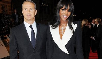 "Russian real estate entrepreneur Vladislav Doronin (left) and model Naomi Campbell arrive at the world premiere of ""Skyfall"" at the Royal Albert Hall on Tuesday, Oct. 23, 2012, in London. (Stewart Wilson/Invision/AP)"