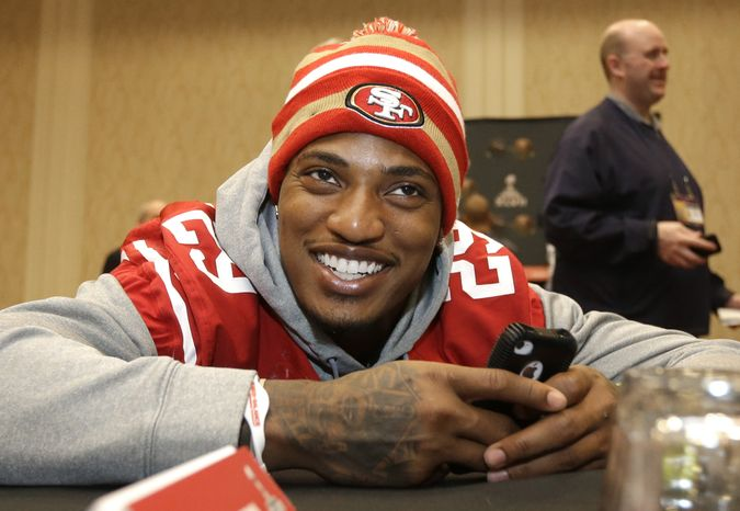 San Francisco 49ers cornerback Chris Culliver talks with teammates during a media availability Wednesday, Jan. 30, 2013, in New Orleans. The 49ers said Wednesday they have addressed anti-gay remarks made by Culliver during a Super Bowl media day interview Tuesday. The 49ers are scheduled to play the Baltimore Ravens in the NFL Super Bowl XLVII football game on Feb. 3. (AP Photo/Mark Humphrey)