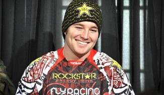 In this photo taken Jan. 25, 2012 and released by ESPN Images, snowmobiler Caleb Moore smiles while attending a news conference at the Winter X Games in Aspen, Colo. (Associated Press/ESPN Images, Eric Lars Bakke)