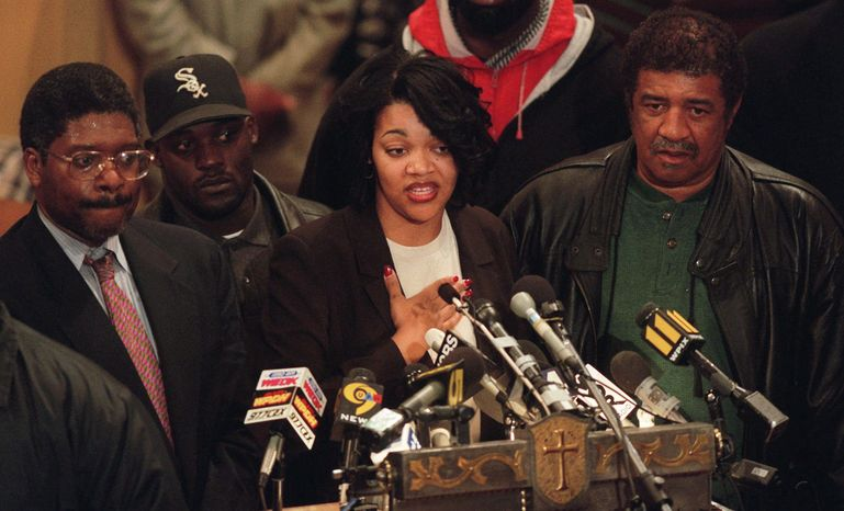 ** FILE ** Tawana Brawley speaks to supporters at Bethany Baptist Church in the Brooklyn borough of New York on Dec. 2, 1997. She is flanked by Alton Maddox (left) and her stepfather Ralph King (right). In 1987, Brawley's allegations of a racially charged rape became a national flashpoint. (Associated Press)