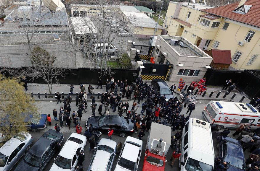 Elevated view of the side entrance of the U.S. Embassy in the Turkish capital, Ankara, after a suspected suicide bomber detonated an explosive device, Friday Feb. 1, 2013. The bomb appeared to have exploded inside the security checkpoint at the entrance of the visa section of the embassy. A police official said at least two people are dead. (AP Photo)