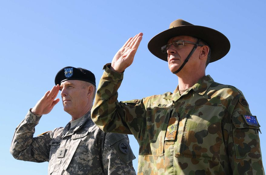 ** FILE ** In this Jan. 17, 2013, photo provided by U.S. Army Pacific, U.S. Army Maj. Gen. Roger Mathews, left, and Australian Defence Forces Maj. Gen. Richard Burr salute during a ceremony welcoming Burr to Fort Shafter, Hawaii. Burr's unprecedented appointment to be deputy commanding general at U.S. Army Pacific is the first time a non-American has served in such a high-ranking position at a command like this. (AP Photo/U.S. Army Pacific, Angela Kershner)