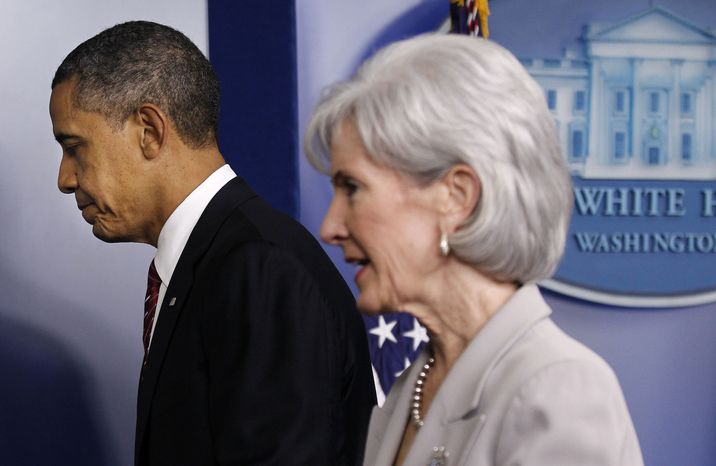 **FILE** President Obama and Health and Human Services Secretary Kathleen Sebelius leave the Brady Press Briefing Room of the White House in Washington on Feb. 10, 2012, after the president announced the revamp of his contraception policy requiring religious institutions to fully pay for birth control. (Associated Press)
