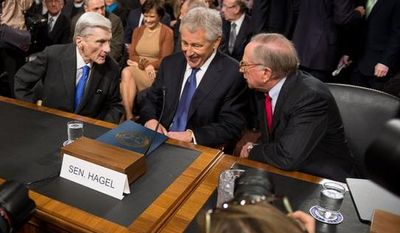 From left: Former Sens. John W. Warner of Virginia, Chuck Hagel of Nebraska and Sam Nunn of Georgia arrive Jan. 31, 2013, on Capitol Hill to testify before the Senate Armed Services Committee at Hagel's confirmation hearing to be the next Secretary of Defense. (Andrew Harnik/The Washington Times)