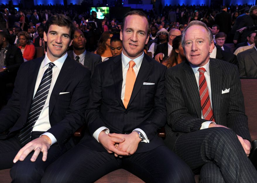 Eli Manning of the New York Giants, left, Peyton Manning of the Denver Broncos, center, and former NFL player Archie Manning at the 2nd Annual NFL Honors on Saturday, Feb. 2, 2013 in New Orleans. (Photo by Jordan Strauss/Invision/AP)
