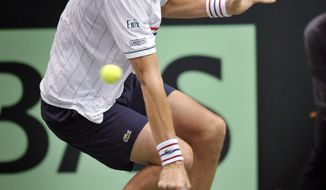 United States' John Isner returns a shot from Brazil's Thiago Alves during a first-round Davis Cup tennis match, Friday, Feb. 1, 2013, in Jacksonville, Fla. Isner won 6-3, 7-6 (4), 6-3. (AP Photo/Florida Times-Union, Will Dickey)