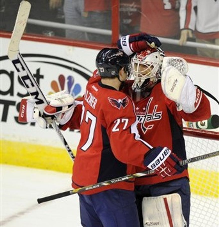 Braden Holtby (right) and Karl Alzner celebrate the Capitals' victory over the Flyers on Feb. 1 (Associated Press)