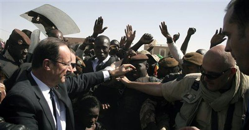French President Francois Hollande visits Timbuktu, Mali, Saturday Feb. 2, 2013. Hollande indicated Friday that during his visit to the former French colony, he would discuss the reduction of French troop levels on the ground to make way for an African force, led by Mali. (Associated Press)
