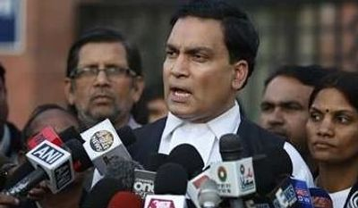 A.P Singh, lawyer for one of the accused, speaks to journalists outside the Saket district court complex where the five men facing charges of rape and murder of a 23-year-old woman aboard a moving bus in the capital last month stand trial, in New Delhi, India, Monday, Jan. 21, 2013. Legal proceedings in the fatal gang-rape attack on the student in India's capital began Monday in a new fast-track court set up to deal specifically with crimes against women that has stirred debate over how best to deliver justice to rape victims.(Associated Press)