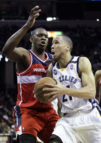 Washington Wizards' Kevin Seraphin, left, of France, defends against Memphis Grizzlies' Tayshaun Prince (21) during the second half of an NBA basketball game in Memphis, Tenn., Friday, Feb. 1, 2013. The Grizzlies defeated the Wizards 85-76. Prince, formerly of the Detroit Pistons, scored 14 points in his Grizzlies debute. (AP Photo/Danny Johnston)
