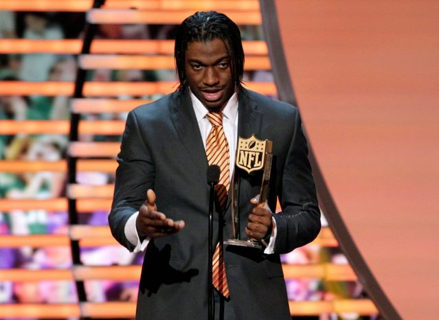 ** FILE ** Robert Griffin III of the Washington Redskins accepts the award for AP Offensive Rookie of the Year presented by Pepsi Max at the 2nd Annual NFL Honors on Saturday, Feb. 2, 2013, in New Orleans. (Photo by AJ Mast/Invision/AP)