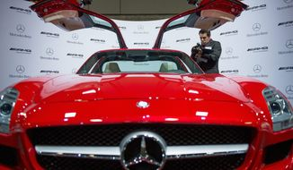 The gull-winged Mercedes-Benz 2012 SLS AMG Coupe starts at more than $200,000, but viewing it costs a lot less at the annual Washington Auto Show. Over the years, while the cars have gotten fancier, auto shows have slimmed down. (Andrew Harnik/The Washington Times)