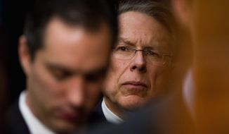 "National Rifle Association CEO and Executive Vice President Wayne LaPierre (background) said on ""Fox News Sunday"" that the American people want enforcement of gun laws already in place. ""They don't want more laws imposed on what is only going to be the law-abiding,"" he said. (Andrew Harnik/The Washington Times)"