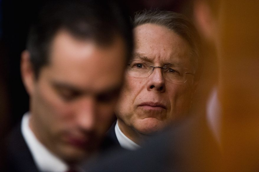 """National Rifle Association CEO and Executive Vice President Wayne LaPierre (background) said on """"Fox News Sunday"""" that the American people want enforcement of gun laws already in place. """"They don't want more laws imposed on what is only going to be the law-abiding,"""" he said. (Andrew Harnik/The Washington Times)"""