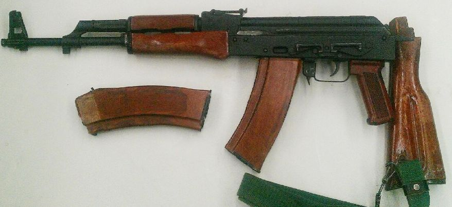 ** FILE ** An AK-47 assault rifle with a high capacity ammunition cartridge was confiscated during one of two undercover sting operations targeting gun traffickers in the Bronx borough of New York on Thursday, Jan. 24, 2013. (AP Photo/New York City Police Department)