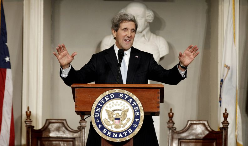 Sen. John F. Kerry acknowledges applause while addressing constituents at Faneuil Hall in Boston on Thursday, Jan. 31, 2013. Mr. Kerry on Friday stepped down from the office he has held for nearly three decades to become the next secretary of state. (AP Photo/Winslow Townson)
