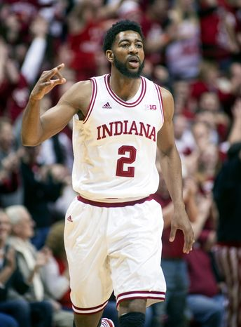 Indiana's Christian Watford (2) reacts after hitting a 3-point basket against Michigan during the first half of an NCAA college basketball game Saturday, Feb. 2, 2013, in Bloomington, Ind. (AP Photo/Doug McSchooler)