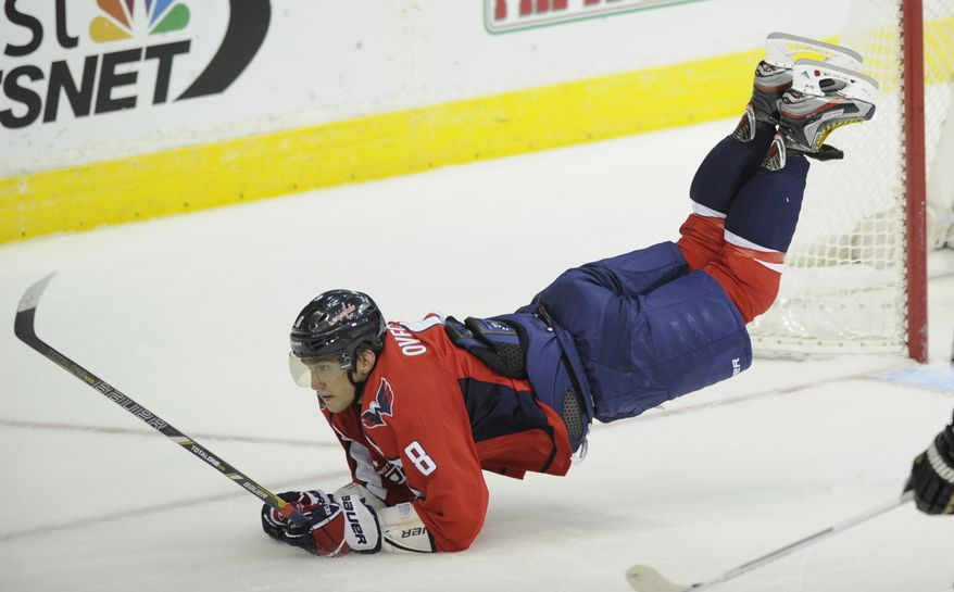 Washington Capitals left wing Alex Ovechkin (8), of Russia, lands on the ice as he went airborne during the third period of an NHL hockey game as against the Pittsburgh Penguins, Sunday, Feb. 3, 2013, in Washington. The Penguins won 6-3. (AP Photo/Nick Wass)