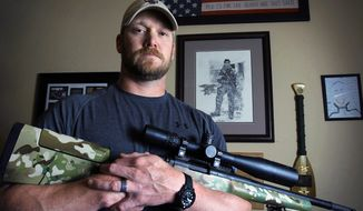 """Chris Kyle, a former Navy SEAL who wrote the book """"American Sniper,"""" poses in Midlothian, Texas, on Friday, April 6, 2012. (AP Photo/The Fort Worth Star-Telegram, Paul Moseley)"""
