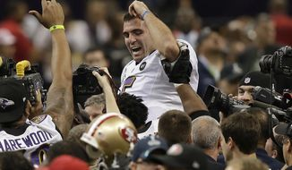 Baltimore Ravens quarterback Joe Flacco (5) is lifted into the air by teammates after defeating the San Francisco 49ers 34-31 in the NFL Super Bowl XLVII football game, Sunday, Feb. 3, 2013, in New Orleans. (AP Photo/Bill Haber)