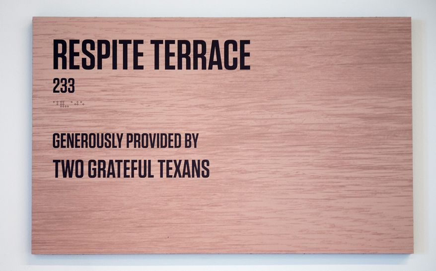 """One of the two terraces at the USO center has a plaque which says it was provided by """"Two Grateful Texans."""" The 20,000-square-foot Warrior and Family Center in Fairfax County, set to open Friday, is the largest in the organization's history. (Andrew Harnik/The Washington Times)"""