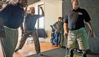 Wounded warrior Charles Eggleston (left), Wes Armstrong with Full Swing Golf and Kathleen Causey watch as her husband, Sgt. 1st Class Aaron Causey tries out a golf simulator in the sports lounge at the USO center at Fort Belvoir on Monday. (Andrew Harnik/The Washington Times)