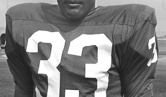 **FILE** - This July 21, 1964 file photo shows Ollie Matson, halfback for the Philadelphia Eagles, posing at the team's training camp in Hershey, Pa. NFL Hall of Famer Matson died of respiratory failure Saturday, Feb. 19, 2011, in Los Angeles, his nephew Art Thompson III told The Associated Press. He was 80. (AP Photo, File)