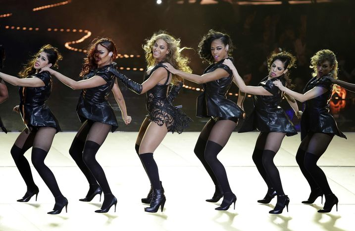 ** FILE ** Beyonce performs during the halftime show of the NFL Super Bowl XLVII football game between the San Francisco 49ers and the Baltimore Ravens, Sunday, Feb. 3, 2013, in New Orleans. (AP Photo/Gerald Herbert)
