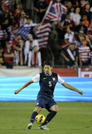 U.S. national team's Omar Gonzalez kicks the ball in the first half of an exhibition game against Canada Tuesday, Jan. 29, 2013, in Houston. (AP Photo/Pat Sullivan)